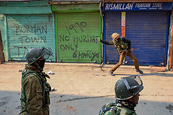 December 18, 2018 - Srinagar, Jammu & Kashmir, India - Indian policeman seen throwing stones towards Protestors during clashes in Srinagar..Clashes erupted soon after the Protestors were detained by Indian policemen in Srinagar during a protest march against the recent civilians killings. The march Protest were called by Separatist leaders after the Indian army killed seven civilians in Pulwama district of Jammu and Kashmir recently. (Credit Image: © Idrees Abbas/SOPA Images via ZUMA Wire)
