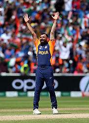 India's Mohammed Shami celebrates taking the wicket of England's Joe Root, caught by Hardik Pandya, during the ICC Cricket World Cup group stage match at Edgbaston, Birmingham.