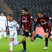 Besiktas's Ricardo QUARESMA (L) and Gaziantepspor's Ismael SOSA (C) during their Turkey Cup semi final soccer firsth match Besiktas between Gaziantepspor at the Inonu stadium in Istanbul Turkey on Wednesday 06 April 2011. Photo by TURKPIX