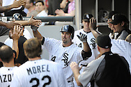 CHICAGO - JUNE 06:  Paul Konerko #14 of the Chicago White Sox is greeted by teammates in the dugout after hitting a home run against the Seattle Mariners in the fourth inning on June 6, 2011 at U.S. Cellular Field in Chicago, Illinois.  The White Sox defeated the Mariners 3-1.  (Photo by Ron Vesely)  Subject:  Paul Konerko