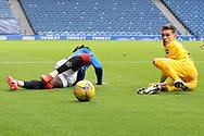 Josh Mullin (Livingston) smashes Calvin Bassey (Rangers) during the Scottish Premiership match between Rangers and Livingston at Ibrox, Glasgow, Scotland on 25 October 2020.