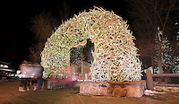 People mill around the southwest antler arch to take in the festive scene in downtown Jackson after the Town Square Lighting ceremony Friday evening.