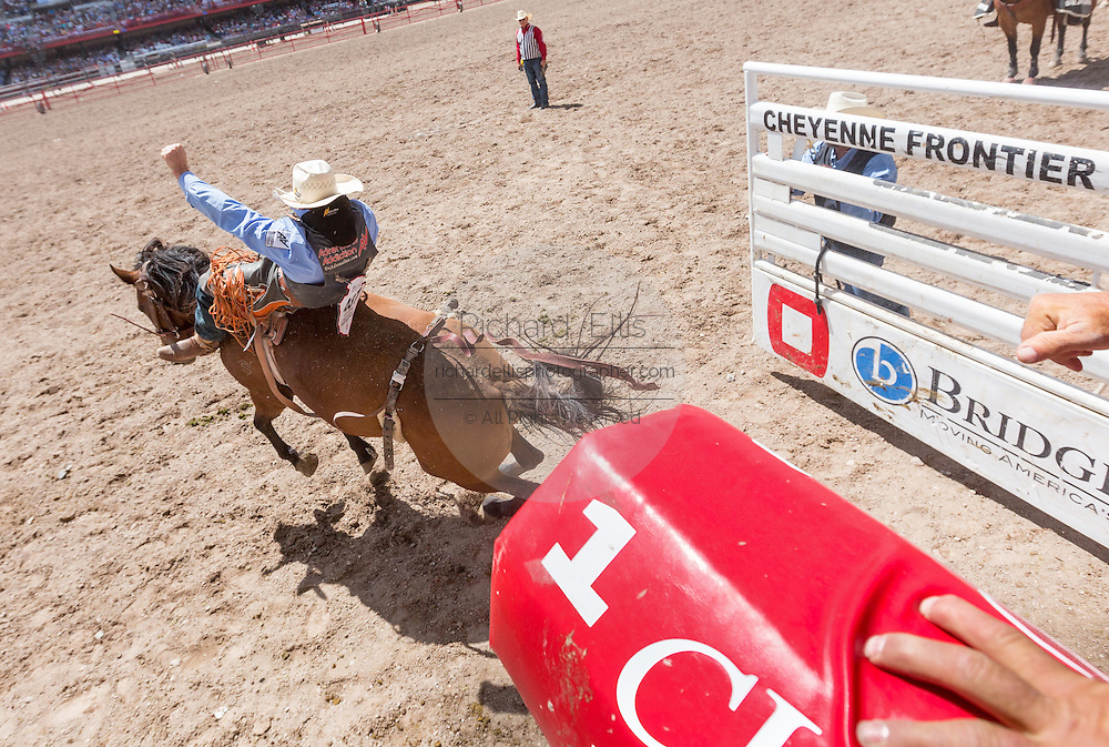 A bareback rider hangs on during rodeo competition at Cheyenne Frontier Days July 25, 2015 in Cheyenne, Wyoming. Frontier Days celebrates the cowboy traditions of the west with a rodeo, parade and fair.