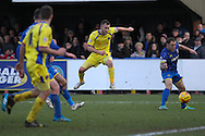 Captain Danny Grainger takes a shot during the Sky Bet League 2 match between AFC Wimbledon and Carlisle United at the Cherry Red Records Stadium, Kingston, England on 17 January 2015. Photo by Stuart Butcher.