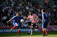 Photo: Jake Eastham.<br /> Southampton v Crewe. Coca Cola Championship.<br /> 27/08/2005.Adie Moses clears the ball as Richard Fuller closes in.