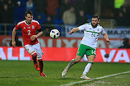 Stuart Dallas of Northern Ireland ® is challenged by Chris Gunter of Wales. Wales v Northern Ireland, International football friendly match at the Cardiff City Stadium in Cardiff, South Wales on Thursday 24th March 2016. The teams are preparing for this summer's Euro 2016 tournament.     pic by  Andrew Orchard, Andrew Orchard sports photography.
