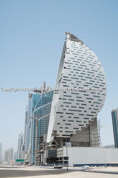 Modern skyscraper under construction at Business Bay district in Dubai United Arab Emirates