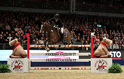 Britain's Allana Clutterbuck riding Atomic Du Barry competes in the Mince Pie Stakes during day seven of the London International Horse Show at London Olympia.