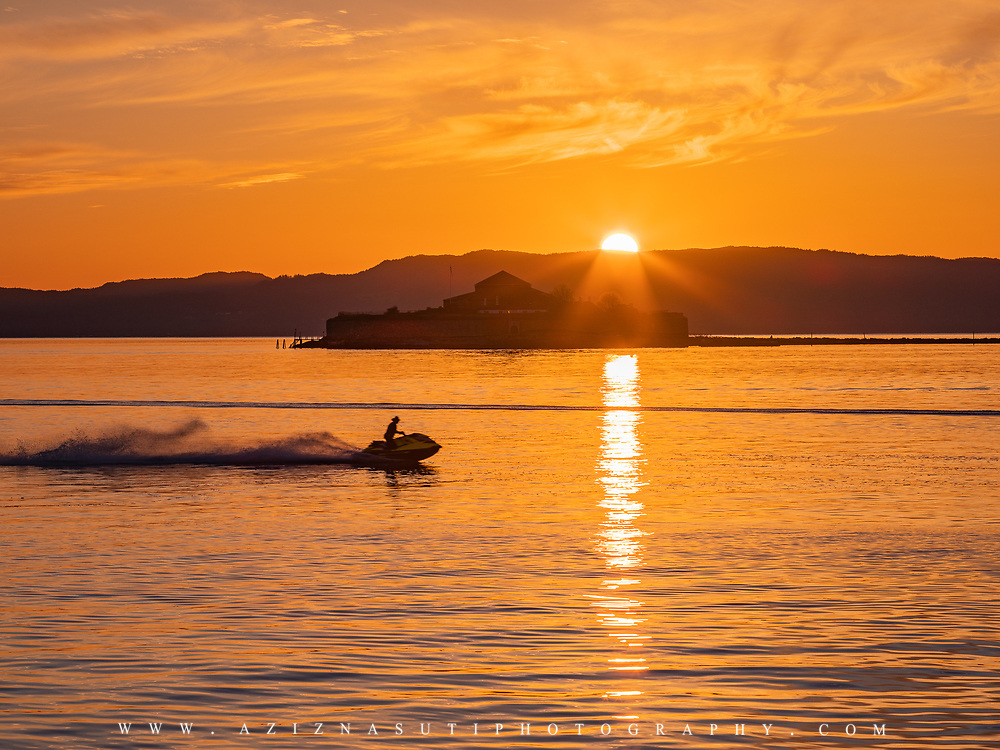 www.aziznasutiphotography.com                                         Picture has been taken from Pirbadet towards the Munkholmen islet in Trondhein in a May late sunset.