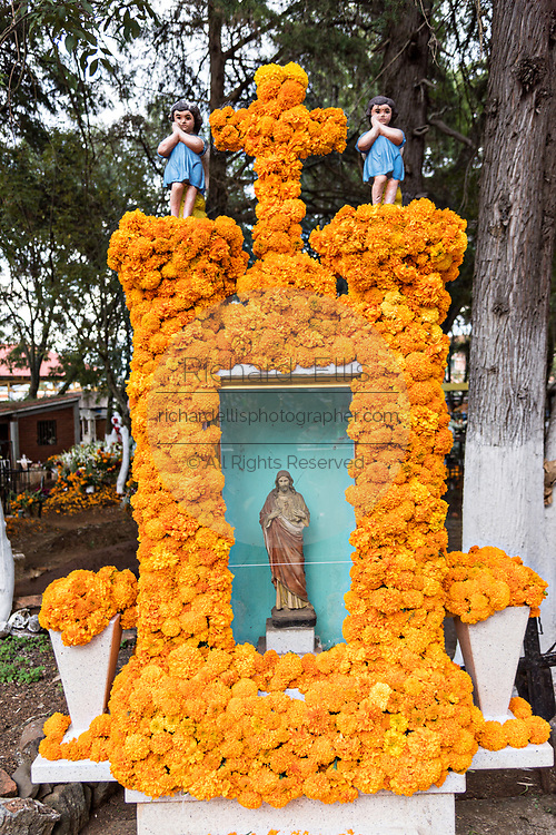 An elaborate floral decoration on a gravesite during the Day of the Dead festival October 31, 2017 in Tzintzuntzan, Michoacan, Mexico. During the festival, which dates back hundreds of years to Aztec rituals, family members decorate the tombs of loved ones and celebrate them with gifts, food and altars.