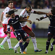 Thierry Henry, New York Red Bulls, is challenged by Lee Nguyen, (left), and Kalifa Cisse, New England Revolution, during the New York Red Bulls V New England Revolution, Major League Soccer regular season match at Red Bull Arena, Harrison, New Jersey. USA. 20th April 2013. Photo Tim Clayton
