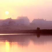 Sun rising through the morning fog in Machias, Maine