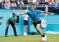 Tennis - 2019 Queen's Club Fever-Tree Championships - Day Three, Wednesday<br /> <br /> Men's Singles, First Round: Stefanos Tsitsipas (GRC) Vs. Kyle Edmund (GBR)<br /> <br /> Stefanos Tsitsipas (GRC) streches to reach the passing shot on Centre Court.<br />  <br /> COLORSPORT/DANIEL BEARHAM