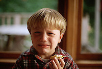 August 1996, San Juan County, Washington, USA --- Four year old Tunui Franken frowns and cries with displeasure as he holds a partially eaten biscuit in one hand. --- Image by © Owen Franken/CORBIS