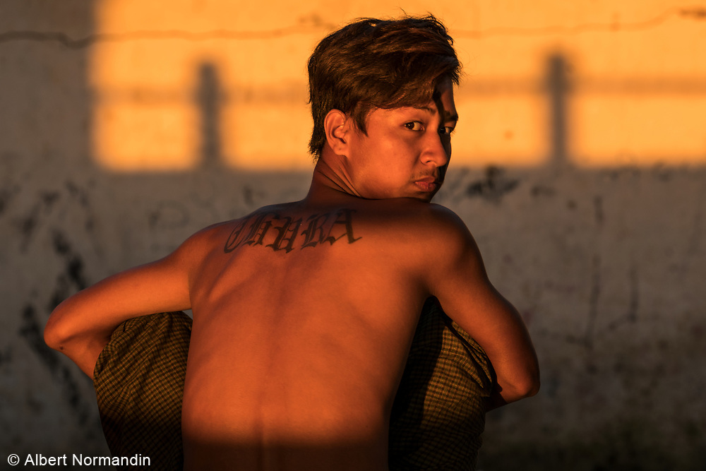 Young man with tattoo, Thura - I Am Brave ,on Chindwin Riverbank, Monywa, Myanmar