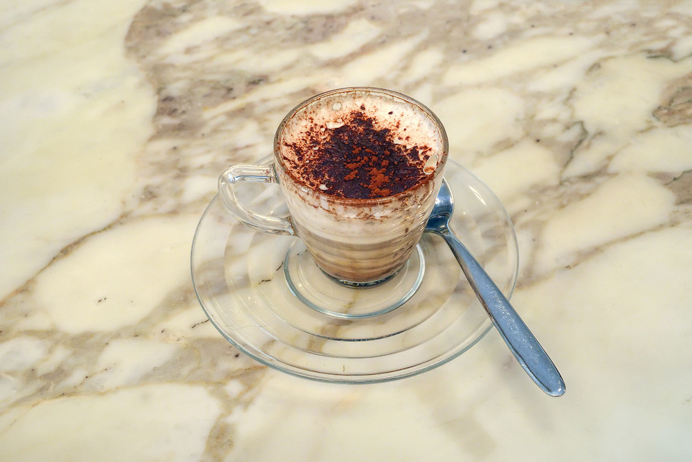 Cup of coffee on the counter of a shop in Bagno Vignoni, Tuscany, Italy.