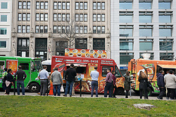 Workers enjoying lunch from food trucks on a Washington downtown street. From a series of travel photos in the United States. Photo date: Thursday, March 29, 2018. Photo credit should read: Richard Gray/EMPICS