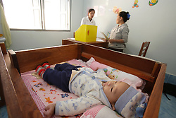 Bounmee aged 30 years old and her son Jimieng over two months old. And has diarrhoea. Somsanouk village, Pak Ou District, Luang Prabang Province, Lao PDR