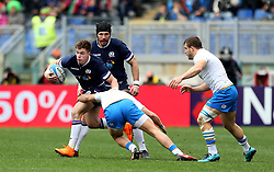 Scotland's Huw Jones in action during the NatWest 6 Nations match at the Stadio Olimpico, Rome.