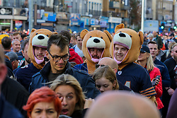 © Licensed to London News Pictures. 06/10/2019. London, UK. Chicago Bears Football fans wearing bear costume arrive for the NFL (The National Football League) London Games when Oakland Raiders faces Chicago Bears in the first of the two games to be played at the new Tottenham Hotspur Stadium. Photo credit: Dinendra Haria/LNP