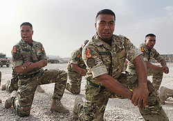 © London News Pictures. 11/06/11. AFGHANISTAN. Members of the Tongan Army take part in a traditional Haka today (11 Jun 11) to mark the end of their six month tour.  The men make up the 55 strong Tongan task force which provides security to Camp Bastion, with the first platoon of men arriving in November 2010. The Tongan Army have previously supported operations in Iraq as members of the British Army.  The kingdom of Tonga, which has a population of just over 100,000, is made up of 169 islands, 39 of which are inhabited, sprinkled over the Pacific Ocean about one-third of the way from New Zealand to Hawaii. .  Caption must read Alison Baskerville/LNP...