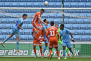 Shrewsbury Town defender James Bolton (13) heads the ball just over the bar during the EFL Sky Bet League 1 match between Coventry City and Shrewsbury Town at the Ricoh Arena, Coventry, England on 28 April 2019.