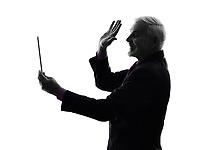 One Caucasian Senior Business Man holding digital tablet saluting Silhouette White Background
