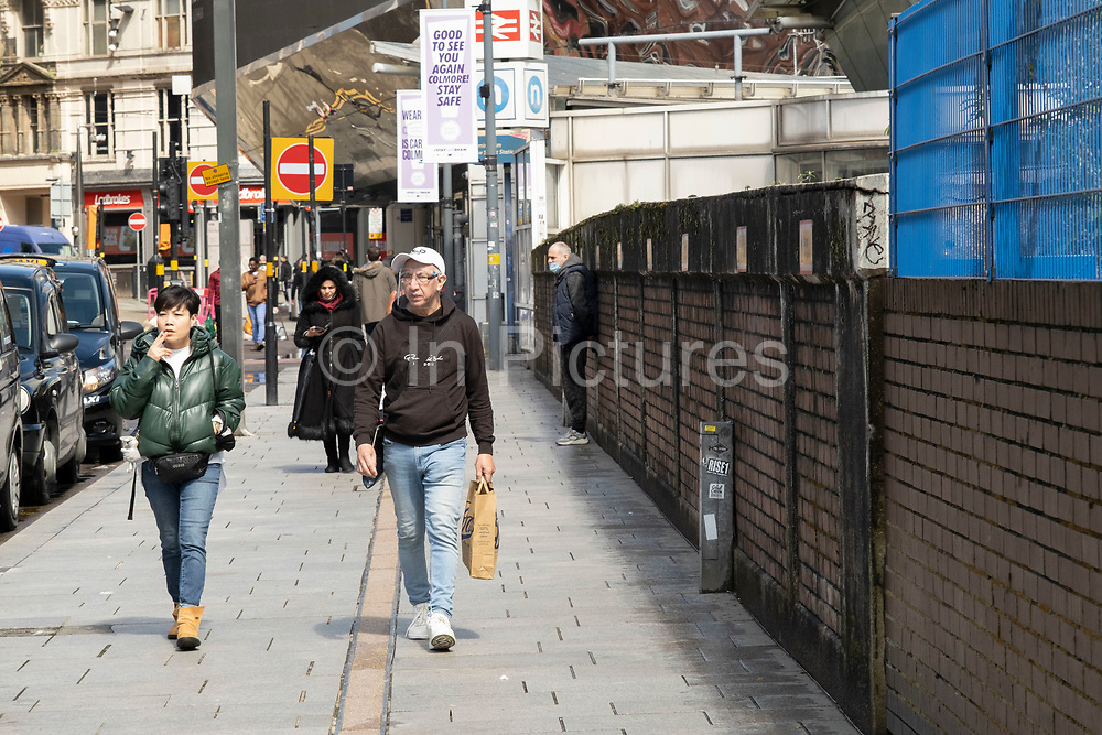 As the coronavirus restrictions continue the process of easing, more people begin to come to the city centre, some wearing face masks or a face shield on 18th May 2021 in Birmingham, United Kingdom. After months of lockdown, the first signs that life will start to get back to normal begin, with more people enjoying the company of others in public, as the rule of six starts the first stage of lockdown ending.