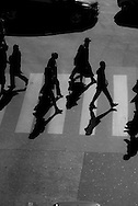 Paris. elevated view on pedestrians crossing a street in winter light