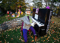 Elton John is in the house with quite the cast of characters in the audience at the Barros' Liberty Hill Scarecrow display.  (Karen Bobotas/for the Laconia Daily Sun)