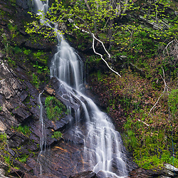 A seasonal waterfalls tumbles down a cliff in the Presumpscot River at Presumpscot Falls in Portland, Maine. Spring.