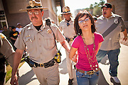 22 FEBRUARY 2011 - PHOENIX, AZ: State Police arrest a protester at the State Capitol in Phoenix Tuesday. Hundreds of people including supporters of immigrants' rights, supporters of border defense, motorcycle riders and members of the Tea Party, converged on the capitol to express their views on bills.     PHOTO BY JACK KURTZ