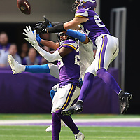 MINNEAPOLIS, MINNESOTA - OCTOBER 10: Xavier Woods #23 and Harrison Smith #22 of the Minnesota Vikings break up a pass intended for Kalif Raymond #11 of the Detroit Lions during the third quarter at U.S. Bank Stadium on October 10, 2021 in Minneapolis, Minnesota. The Vikings defeated the Lions with a three second remaining 55 yard field goal 19-17.(Photo by Adam Bettcher/Getty Images)