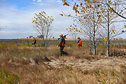 Andrew Johnson, his son Gavin and stepson Noah Watson walk through wildlife habitat land created by Andrew's late friend Steve Bierle during the pheasant season opener on Saturday, October 17, 2020, near Olivet, South Dakota. Bierle died in 2015, and every year his family and friends carry on the hunting tradition to honor his memory.
