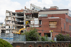 © Licensed to London News Pictures. 27/06/2014. London, UK. Demolition of the former News International site in Wapping, East London on 27th June 2014. The 15 acre site was sold by News International (now News UK) for £150 million to St George of the Berkeley Group in 2012, who have renamed the site London Dock and have won planning permission to build up to 1800 new homes and a new secondary school. Photo credit : Vickie Flores/LNP