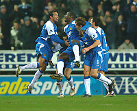 Photo: Paul Greenwood.<br />Wigan Athletic v Chelsea. The Barclays Premiership. 23/12/2006. Wigan's Emile Heskey, centre, is carried, by ecstatic team mates