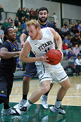 07 December 2016:  Colin Bonnett works underneath with Darius Brown during an NCAA men's division 3 CCIW basketball game between the North Park Vikings and the Illinois Wesleyan Titans in Shirk Center, Bloomington IL