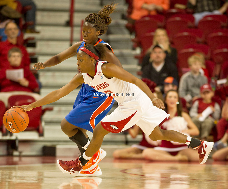 Jan 29, 2012; Fayetteville, AR, USA; Arkansas Razorbacks guard C'eira Ricketts (22) reaches for a loose ball pas Florida Gators guard Jaterra Bonds (10) during a game at Bud Walton Arena. Arkansas defeated Florida 73-72 in the second overtime. Mandatory Credit: Beth Hall-US PRESSWIRE