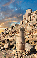 Statue head at sunrise of Apollo in front of the stone pyramid 62 BC Royal Tomb of King Antiochus I Theos of Commagene, east Terrace, Mount Nemrut or Nemrud Dagi summit, near Adıyaman, Turkey .<br /> <br /> If you prefer to buy from our ALAMY PHOTO LIBRARY  Collection visit : https://www.alamy.com/portfolio/paul-williams-funkystock/nemrutdagiancientstatues-turkey.html<br /> <br /> Visit our CLASSICAL WORLD HISTORIC SITES PHOTO COLLECTIONS for more photos to download or buy as wall art prints https://funkystock.photoshelter.com/gallery-collection/Classical-Era-Historic-Sites-Archaeological-Sites-Pictures-Images/C0000g4bSGiDL9rw