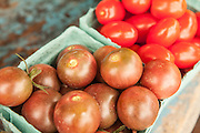 Baskets of tomatoes for sale at Walker's Roadside Stand in Little Compton, Rhode Island.