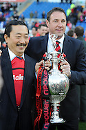 Cardiff city manager Malky Mackay poses with club owner Vincent Tan (l) and the championship trophy.  NPower championship, Cardiff city v Bolton Wanderers at the Cardiff city Stadium in Cardiff, South Wales on Saturday 27th April 2013. pic by Andrew Orchard,  Andrew Orchard sports photography,