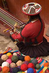 South America, Peru, Chinchero (near Cuzco), woman weaving using backstrap loom.  MR