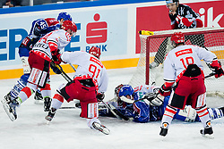 Gaper Kroselj (HK Acroni Jesenice, #32) covers a puck during ice-hockey match between KHL Medvescak Zagreb and HK Acroni Jesenice in 39th Round of EBEL league, on Januar 8, 2012 at Arena Zagreb, Zagreb, Croatia. (Photo By Matic Klansek Velej / Sportida)