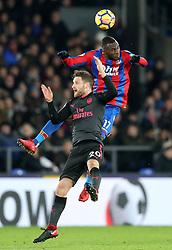 Arsenal's Shkodran Mustafi (left) and Crystal Palace's Christian Benteke battle for the ball during the Premier League match at Selhurst Park, London, Thursday 28th December 2017