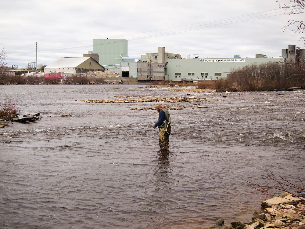Fly fishing for steelhead rainbow trout on the Manistique River in Manistique Michigan a Lake Michigan tributary.