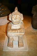 Seated sandstone  figure of Mictlantecuhtli; Aztec, AD 1325-1521. Mexico. Mictlantecuhtli was an Aztec god associated with death.   Pre-Columbian Mesoamerican Mythology Sculpture