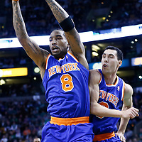 24 January 2013: New York Knicks shooting guard J.R. Smith (8) grabs a rebound next to New York Knicks point guard Pablo Prigioni (9) during the New York Knicks 89-86 victory over the  at the TD Garden, Boston, Massachusetts, USA.