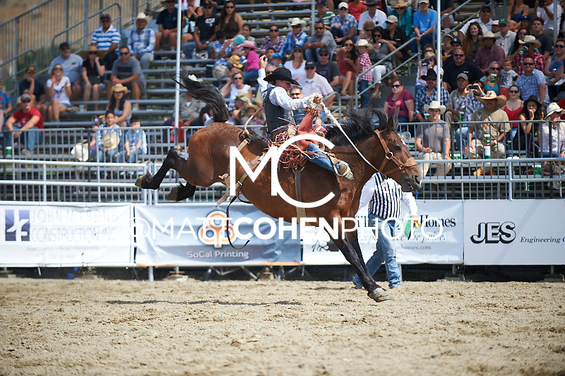Saddle bronc rider Cole Elshere of Faith, SD rides 414 Faded Dice at the Rancho Mission Viejo Rodeo in San Juan Capistrano, CA.  <br /> <br /> <br /> UNEDITED LOW-RES PREVIEW<br /> <br /> <br /> File shown may be an unedited low resolution version used as a proof only. All prints are 100% guaranteed for quality. Sizes 8x10+ come with a version for personal social media. I am currently not selling downloads for commercial/brand use.