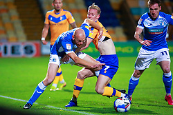 Jason Taylor of Barrow pulls the shirt of Harry Charsley of Mansfield Town - Mandatory by-line: Ryan Crockett/JMP - 27/10/2020 - FOOTBALL - One Call Stadium - Mansfield, England - Mansfield Town v Barrow - Sky Bet League Two