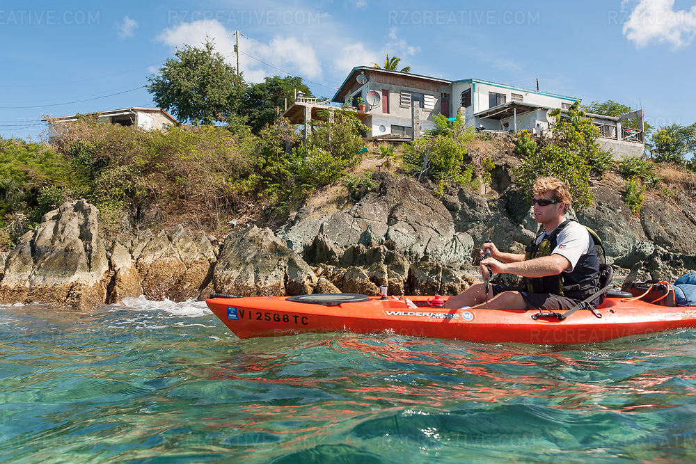 Mark Anders paddles a kayak around Contant Point on the island of St. John, USVI. © Robert Zaleski / rzcreative.com<br /> —<br /> To license this image contact: robert@rzcreative.com
